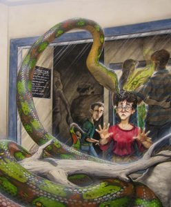 Harry talking to the snake at the zoo.