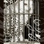Hedwig locked in a cage.